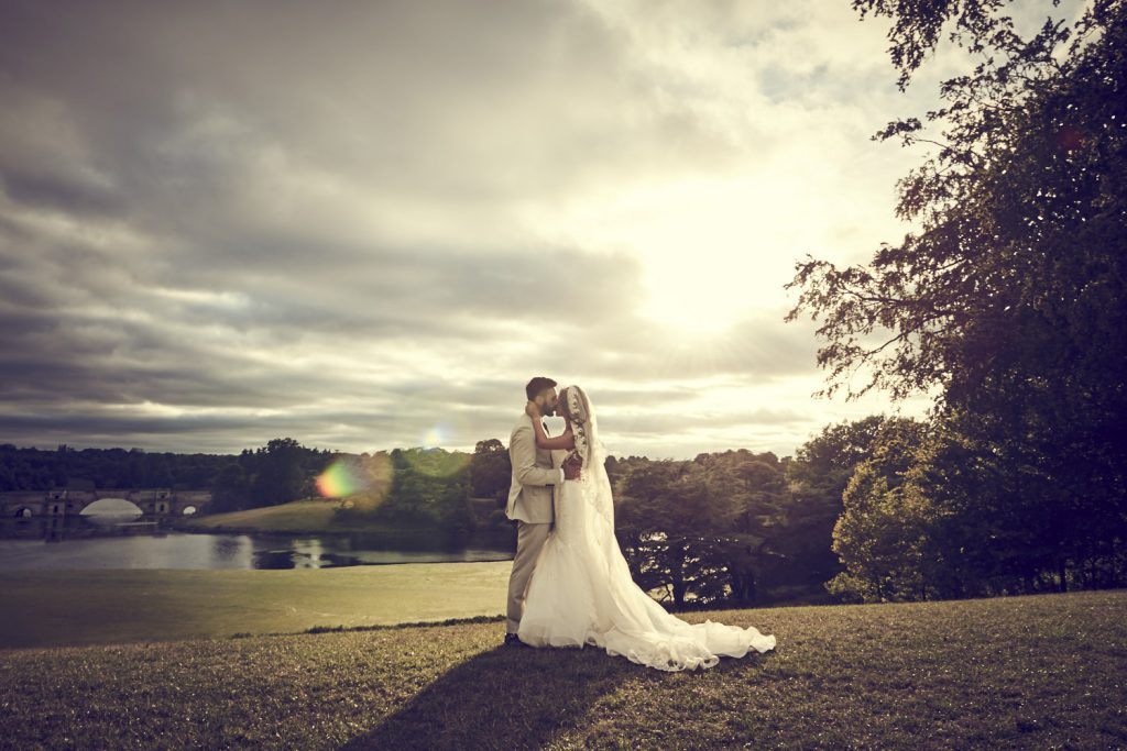 wedding couple with sunset at blenheim palace